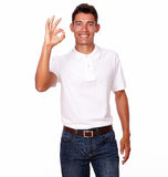 Young attractive man with an ok finger sign. Stock Images