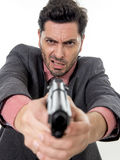 Young attractive man pointing gun in aggressive and upset face e Royalty Free Stock Images