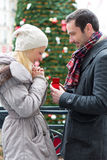 Young attractive man propose marriage to his love Royalty Free Stock Images