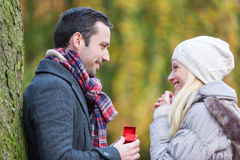 Young attractive man propose marriage to his love Stock Photography