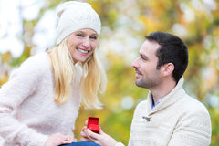 Young attractive man propose marriage to his love Royalty Free Stock Photography