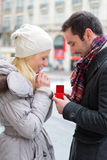 Young attractive man propose marriage to his love Royalty Free Stock Photos