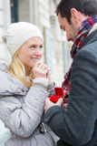 Young attractive man propose marriage to his love Stock Images