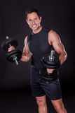 Young Attractive Man Pumping Weights Royalty Free Stock Photos