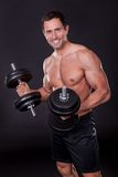 Young attractive man pumping weights Stock Photo