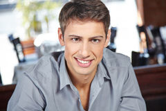 Young attractive man in restaurant Royalty Free Stock Photography