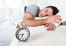 Young attractive man sleeping on bed Royalty Free Stock Photography