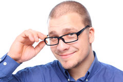 Young  attractive man smiling. Young  attractive man  smiling in black eyeglasses  isolated on white background with copy space Royalty Free Stock Photography