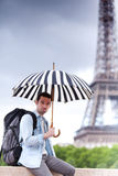 Young attractive man suffering rain in Paris Stock Photo