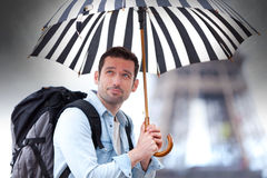 Young attractive man suffering rain in Paris Royalty Free Stock Photography