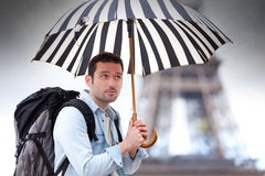 Young attractive man suffering rain in Paris. View of a Young attractive man suffering rain in PARIS in Paris Royalty Free Stock Images