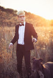 Young attractive man in suit and tie with a greyhound dog in aut Royalty Free Stock Image