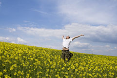 Young attractive man in summer field. Young attractive man jumping in summer field Royalty Free Stock Images