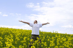 Young attractive man in summer field. Young attractive man jumping in summer field Royalty Free Stock Photo