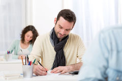 Young attractive man taking competitive exam Stock Images