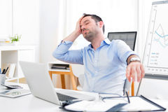 Young attractive man too tired to work Stock Photography