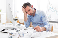 Young attractive man too tired to work Royalty Free Stock Images