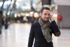 Young attractive man transiting a railway station Royalty Free Stock Photos