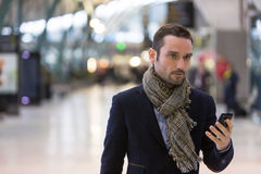 Young attractive man transiting a railway station Royalty Free Stock Photography