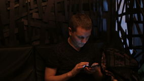 Young attractive man using cellphone in bar. Young attractive man using smartphone in bar stock video footage