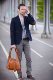 Young attractive man using smartphone in Paris Stock Photography