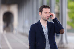 Young attractive man using smartphone in Paris Royalty Free Stock Image