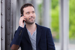 Young attractive man using smartphone in Paris Stock Photos