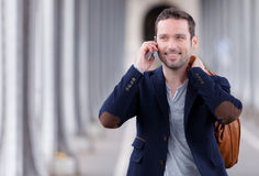 Young attractive man using smartphone in Paris Stock Images
