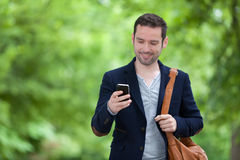 Young attractive man using smartphone in Paris Royalty Free Stock Photo