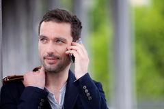 Young attractive man using smartphone in Paris Royalty Free Stock Photography