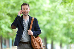 Young attractive man using smartphone in Paris Royalty Free Stock Images