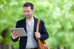 Young attractive man using tablet in Paris Stock Image