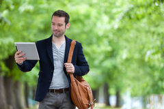 Young attractive man using tablet in Paris Royalty Free Stock Image
