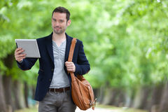 Young attractive man using tablet in Paris Royalty Free Stock Photo