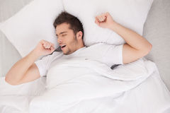 Young attractive man waking in morning. Royalty Free Stock Images