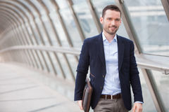 Young attractive man walking in a airport hall royalty free stock image