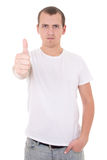 Young attractive man in white  t-shirt thumbs up isolated on whi Stock Images