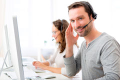 Young attractive man working in a call center Royalty Free Stock Image