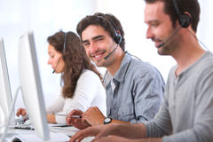 Young attractive man working in a call center Stock Images