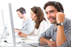 Young attractive man working in a call center Stock Image
