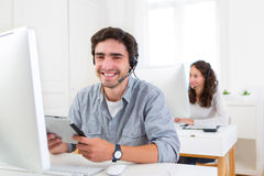 Young attractive man working in a call center Stock Photography