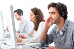 Young attractive man working in a call center Royalty Free Stock Photography