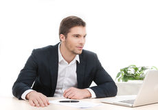 Young attractive man working at his work. Stock Photo