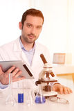 Young attractive man working in a laboratory Stock Image