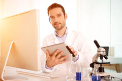 Young attractive man working in a laboratory Royalty Free Stock Image