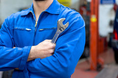 Free Young Attractive Mechanic Working On A Car At The Garage Royalty Free Stock Photography - 63264657