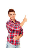Young attractive men pointing something with the hand Stock Image
