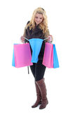 Young attractive model with bags over white Royalty Free Stock Photography