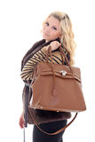Young attractive model posing with handbag Stock Photos