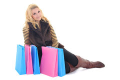 Young attractive model sitting with bags Stock Photography